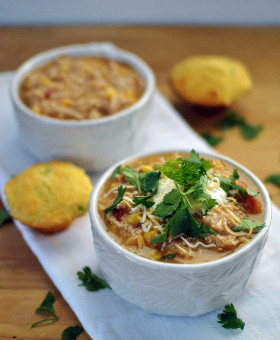 Healthy Slow Cooker White Chicken Chili warms the body and soul on any chilly day. Lean chicken, vegetables, beans & fresh herbs combine with greek yogurt for a healthy chili to feed a crowd on game-day or your family on any weeknight. | Becky's Best Bites