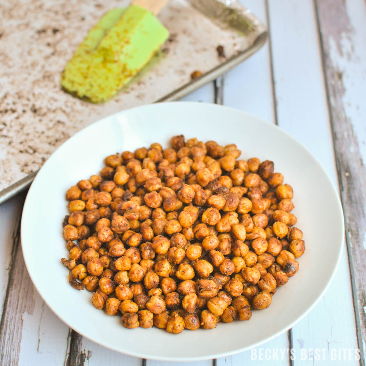 Smoky Spice Blend Roasted Chickpeas is a healthy recipe that is an ideal high fiber snack or appetizer. Throw a handful in salads for added crunch & texture. beckysbestbites.com