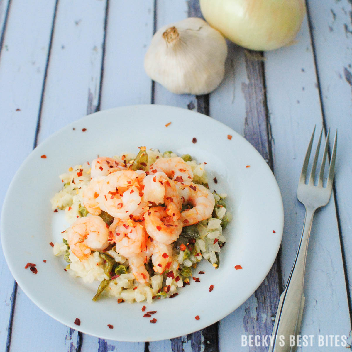 Spicy Shrimp Scampi Risotto with Garden Fresh Peas is made without butter or cheese for a healthy dinner recipe easy enough for any weekday night but yummy enough for any special meal. | beckysbestbites.com