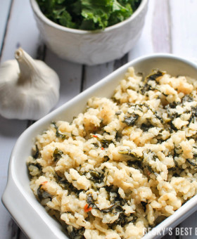 Creamy Kale Risotto with Parmesan is made without butter or cream. A healthy dinner recipe as a side with a lean protein or as a yummy vegetarian main dish. | beckysbestbites.com
