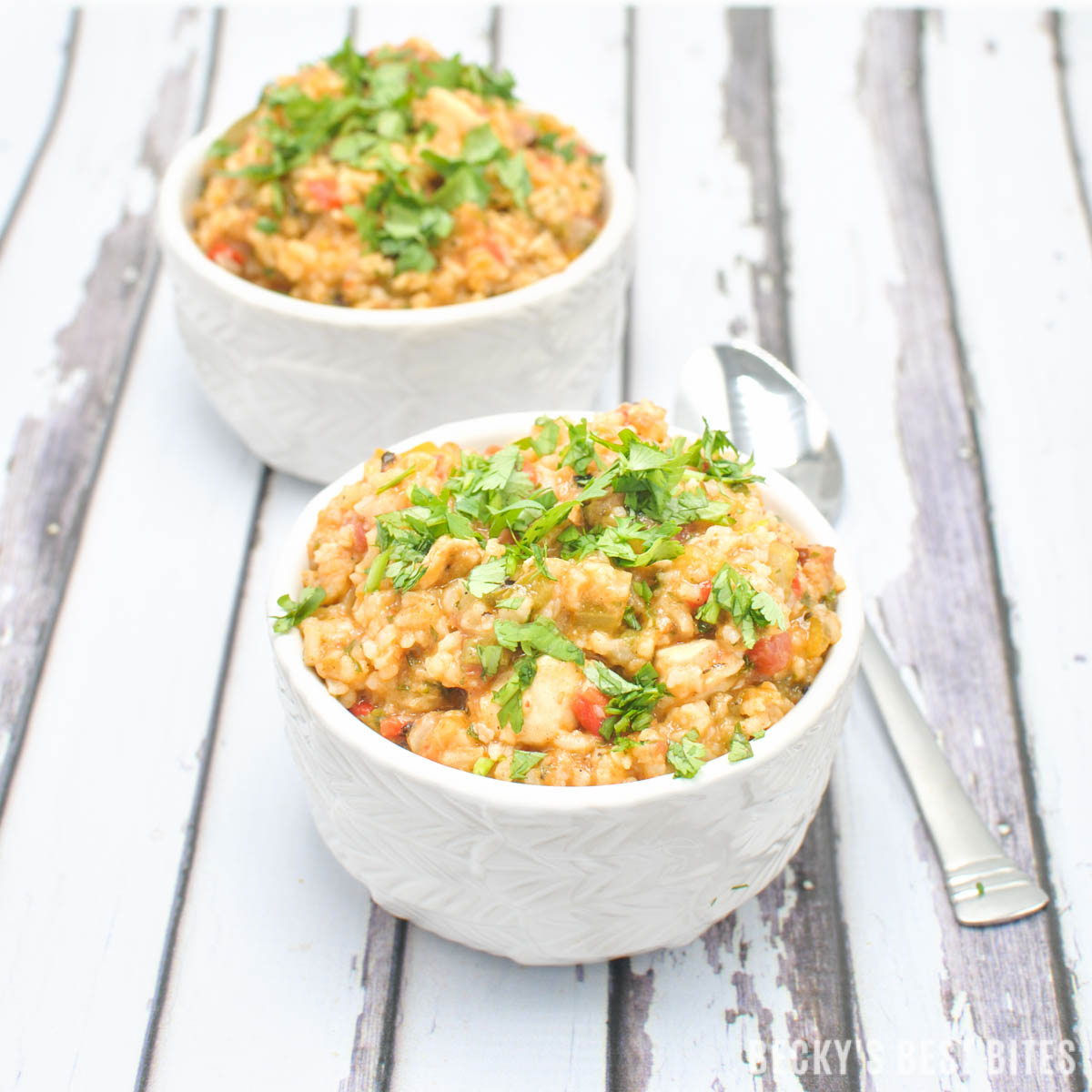 Hubby's Spicy Jambalaya Recipe is a Mardi Gras inspired meal to add to any game day spread. Protein packed dinner with smoked sausage, chicken and shrimp! | beckysbestbites.com