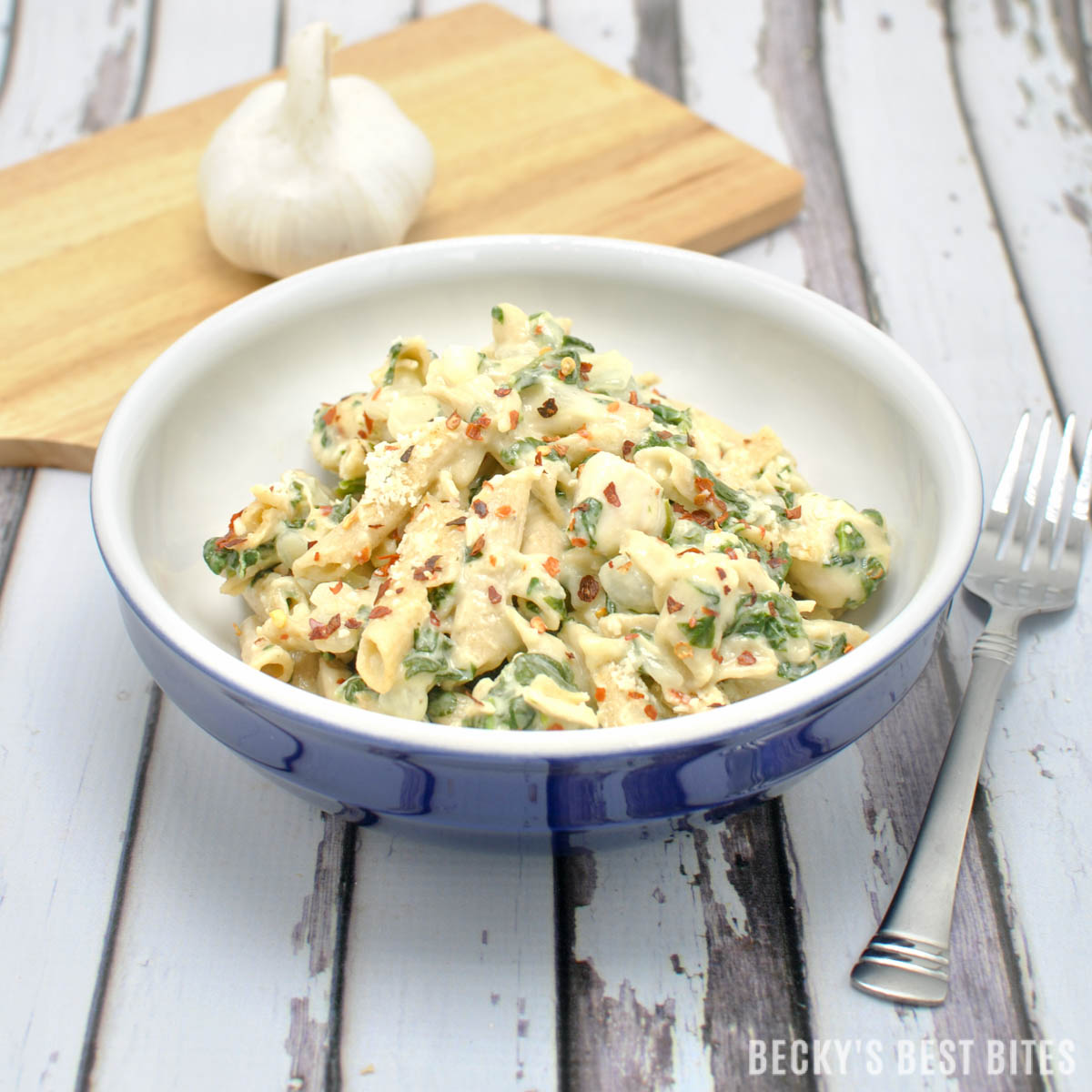 Skip the long waits at restaurants this weekend and make Creamy Garlic Spinach Chicken Pasta meal for your Valentine! This easy, healthy dinner recipe will melt their heart!! | beckysbestbites.com