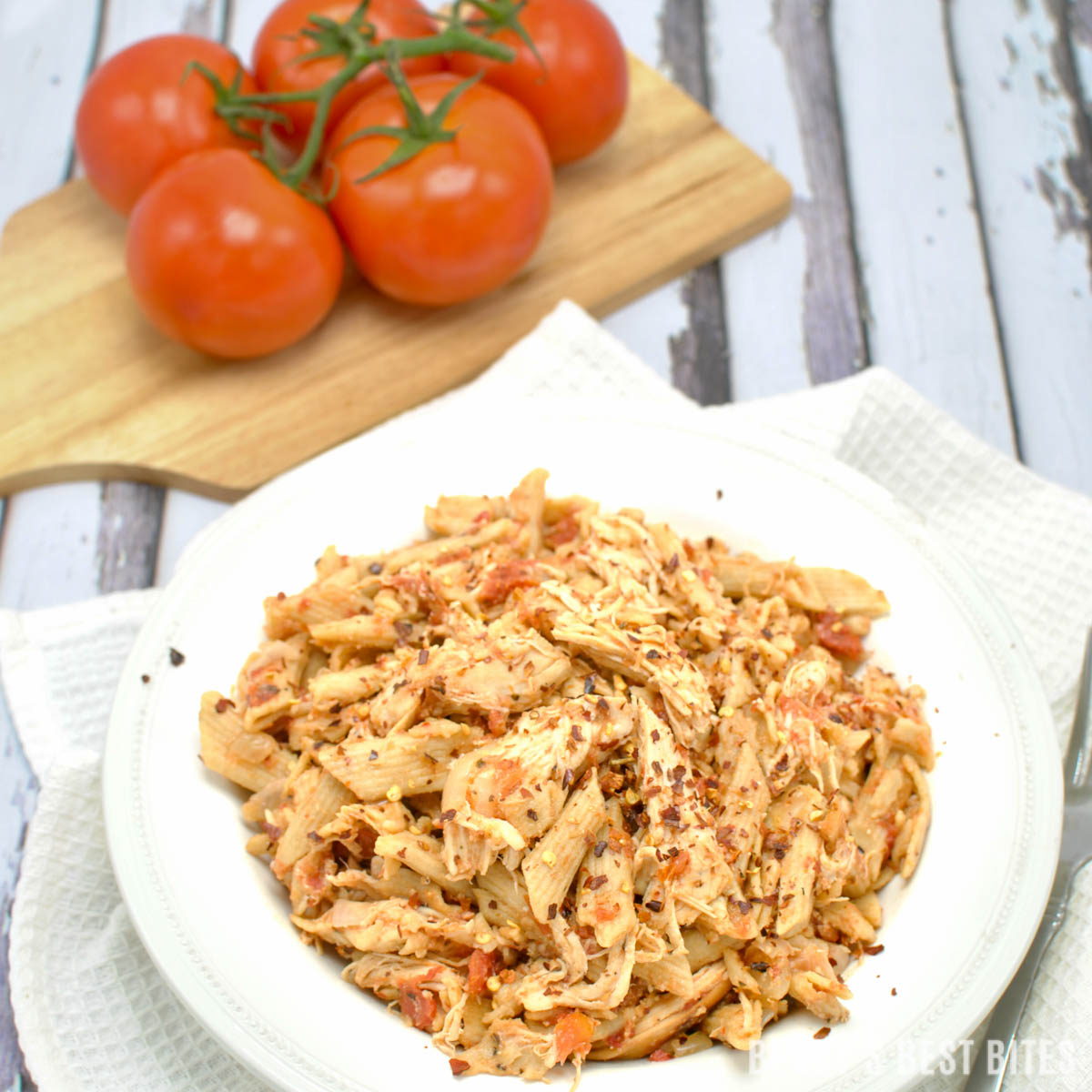 Slow Cooker Chicken Cacciatore is a one-pot easy and healthy weeknight dinner recipe. This version is a twist on the Italian classic with tomatoes, harissa, onion & garlic over whole wheat pasta | beckysbestbites.com