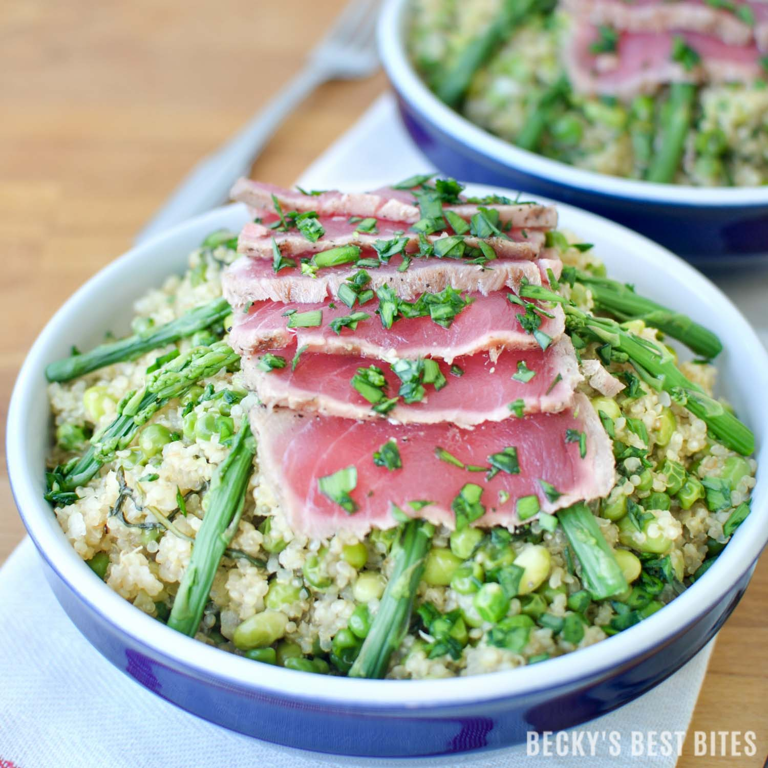 """Spring Quinoa Risotto and Seared Ahi Tuna Bowls combine edamame, asparagus, sweet peas and arugula in a creamy rice dish topped with sushi quality, """"thaw and serve"""" ahi tuna with a Garlic-Peppercorn Rub. #BBSuperFresh #Seafoodies #ad"""