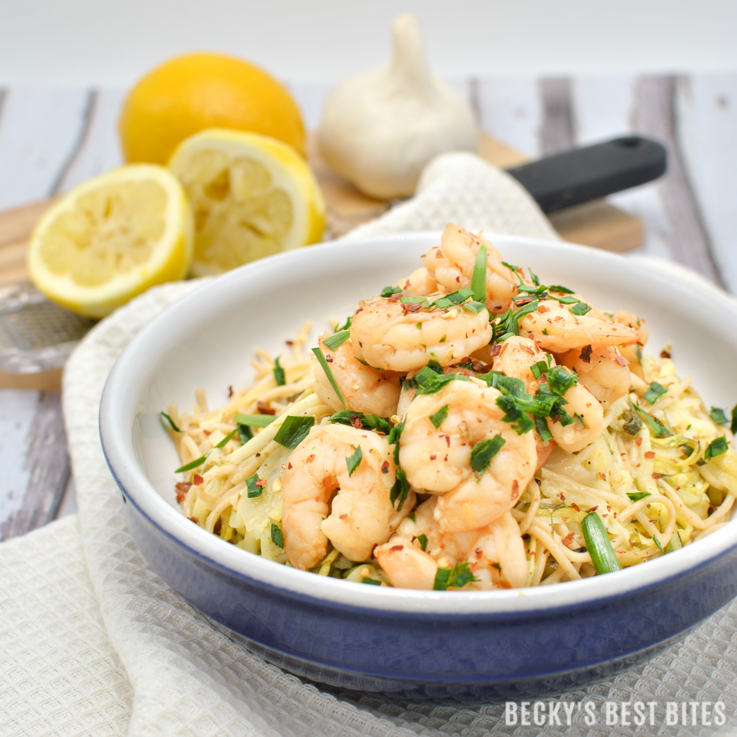 Easy Shrimp Scampi with Zoodles and Noodles is an easy and healthy weeknight dinner recipe. Introduce your family to healthier zucchini noodles by adding them to regular whole grain pasta for a fun way to add more veggies to their diets!| beckysbestbites.com