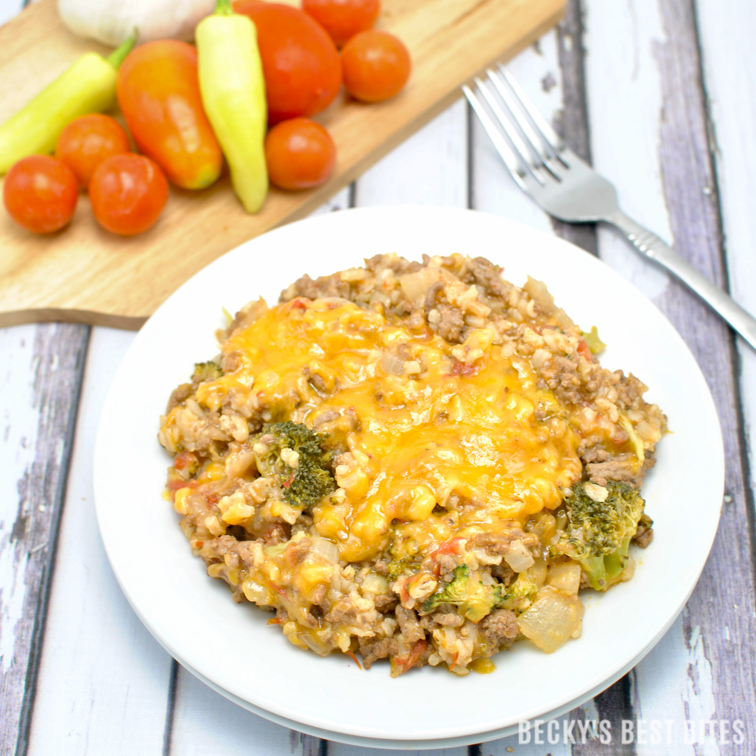 Cheesy Burger Skillet with Fresh Tomatoes, Broccoli and Rice is a healthy & easy one-pot weekday dinner recipe that is ready in 30 minutes or less. A new family meal favorite that includes fresh veggies and brown rice so you can feel good about serving it and the kiddos will love it!  beckysbestbites.com