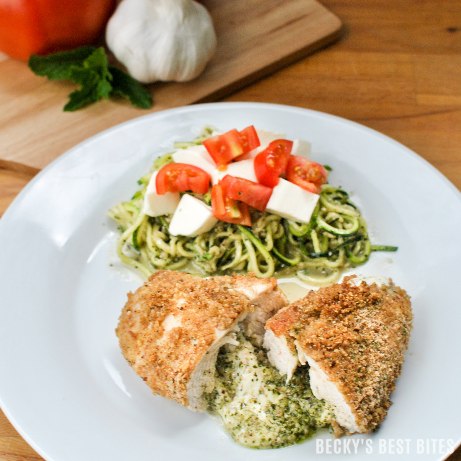 Lemon Mint Pesto and Mozzarella Stuffed Chicken with Zoodles is healthy and easy for any family meal or entertaining! Cooking Italian food doesn't have to be complicated! Try this tasty recipe made with Stella® Fresh Mozzarella! | beckysbestbites.com #FreshisBest