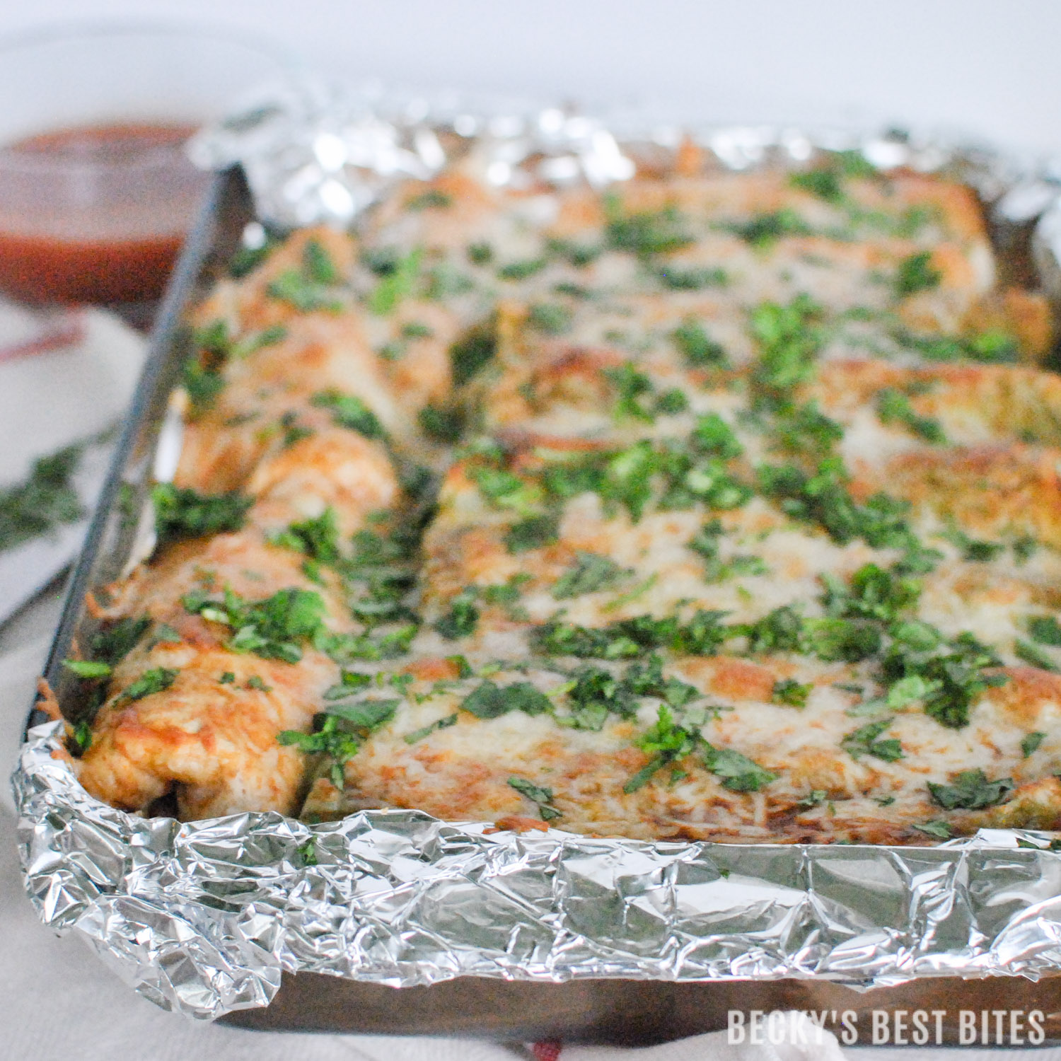 Veggie Packed Easy Chicken Enchiladas are perfect for family weeknight dinner & ready in 30 minutes. Be a kitchen pro and make cleanup a breeze by lining the pan with Glad™ Aluminum Foil before baking.   beckysbestbites.com