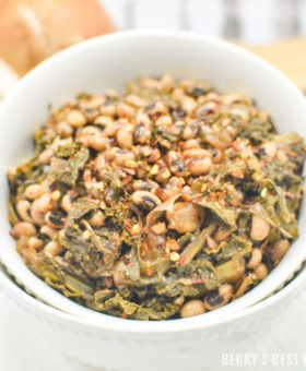 Slow Cooker Black-Eyed Peas with Kale and Garlic is an easy, tasty vegan recipe to kick off your healthy living/eating New Year's resolutions! Serve it as a vegetarian main dish that will satisfy even meat-eaters or hearty side dish to complement grilled meats. | beckysbestbites.com