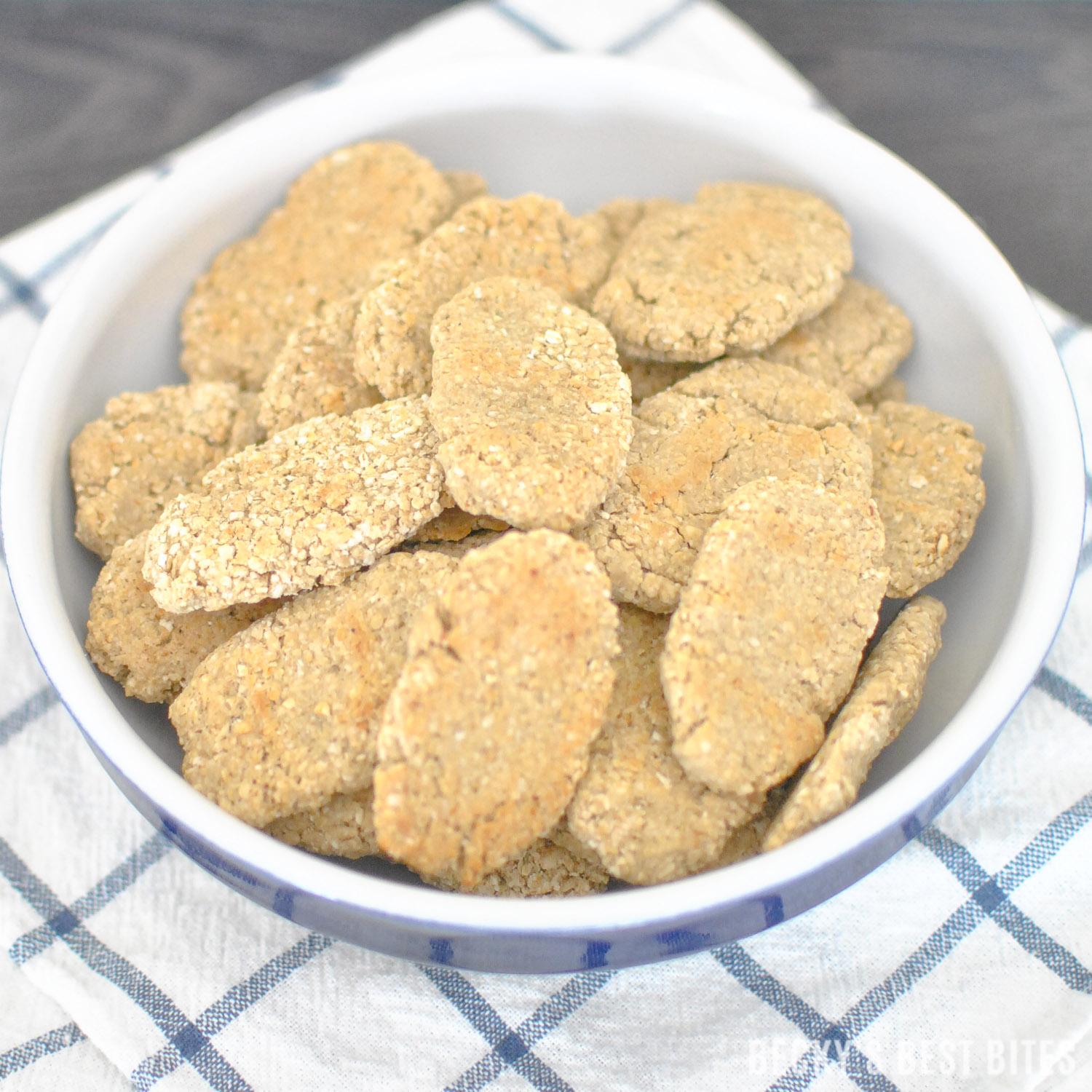 3 Ingredient Baby Teething Biscuits is a healthy and easy recipe for infants and toddlers. Oats, bananas and coconut oil combine with optional spices to make a yummy and cheaper alternative to commercial teether wafers. | beckysbestbites.com