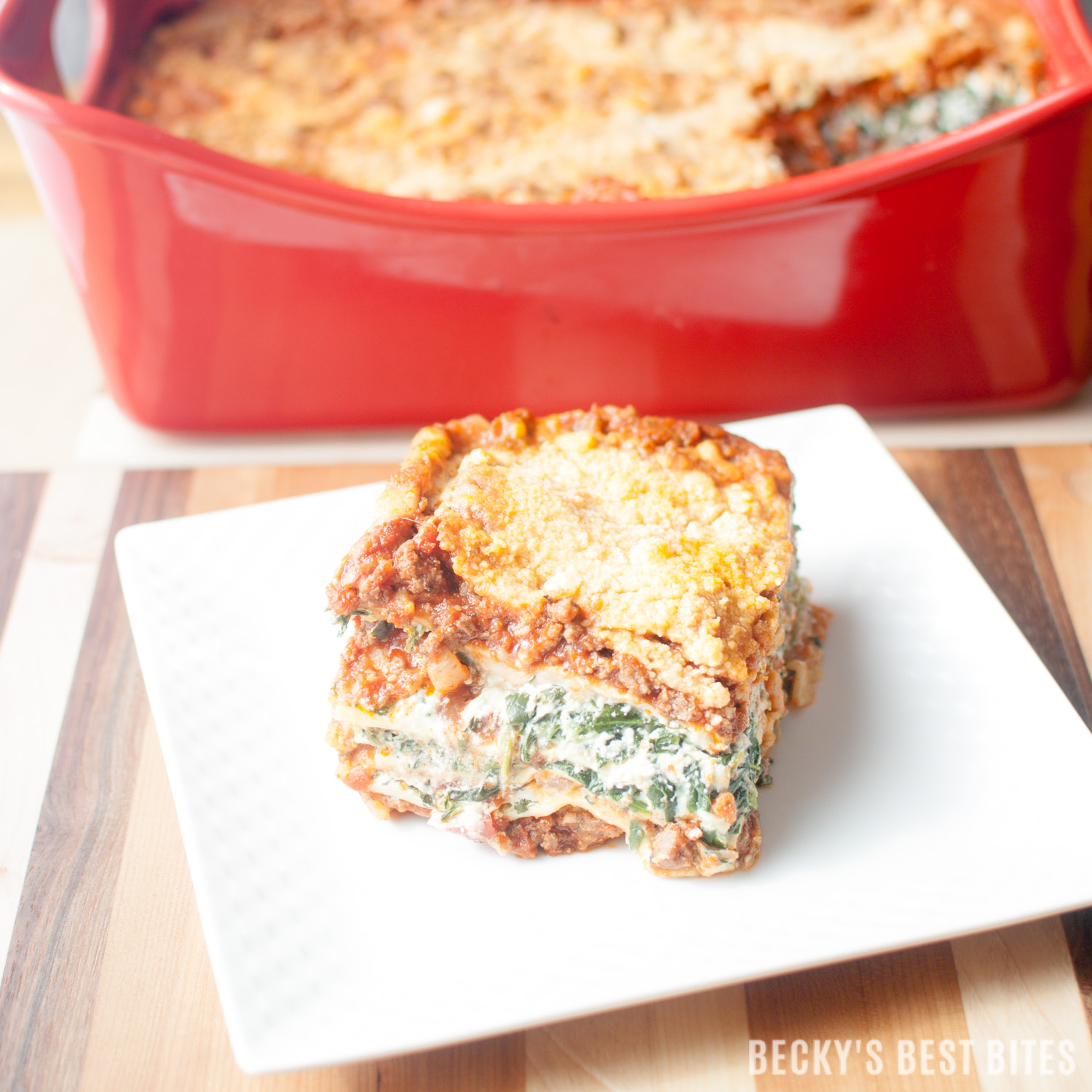 Meat & Veggie Lovers Family Lasagna is the perfect recipe to please a crowd! Ground beef and sausage pair beautifully with garlic, onion, tomatoes, bell peppers, spinach and 3 types of cheeses to make a delicious freezer friendly & make ahead meal that will be requested time and time again. | beckysbestbites.com